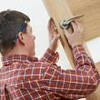 Male carpenter at lock installation — Stock Photo