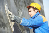Builder worker at plastering facade work — Stock Photo