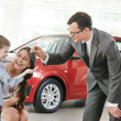 Stock Photo: Car purchasing at automobile sale centre