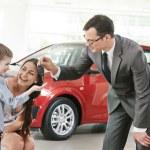 Car purchasing at automobile sale centre — Stock Photo