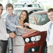 Family buying a car — Stock Photo #30040793