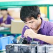 Stockfoto: Chinese worker at manufacturing