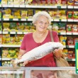 Woman at supermarket — Stock Photo