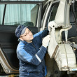 Stock Photo: Male auto mechanic repairing body car