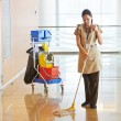 Stock Photo: Female worker cleaning business hall