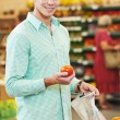 Man shopping at store — Stock Photo