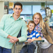 Young family at store — Stock Photo #30063741