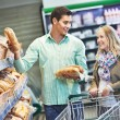 Young family at store — Stock Photo #30063839