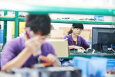Female chinese worker in factory — Stock Photo