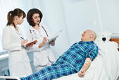 Medic doctor in hospital with patient — Stock Photo
