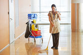 Female worker cleaning business hall — Stock Photo