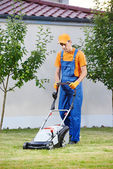 Lawn mower worker — Stock Photo