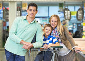 Young family at store — Stock Photo