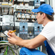 Stock Photo: Electriciworker inspecting
