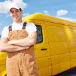 Delivery man with distribution van — Stock Photo