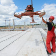 Worker installing concrete slab — Stockfoto
