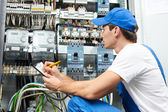 Electrician worker inspecting — Stock Photo
