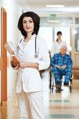 Young happy medic nurse in hospital — Stock Photo