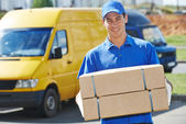 Delivery man with parcel box — Foto Stock