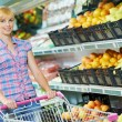 Woman shopping fruits — Stock Photo
