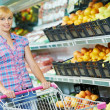 Stock Photo: Woman shopping fruits