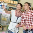 Family at food shopping in supermarket — Stock Photo #30487243