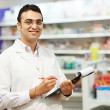 Stock Photo: Pharmacy chemist womin drugstore
