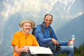 Smiling tourist hiker in india mountains — Stock Photo