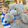 Little boy with bear toy — Stock Photo