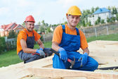 Carpenter workers on roof — Stock Photo