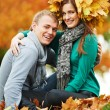 Young peoples at autumn outdoors — Stock Photo #30769579