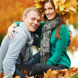 Young peoples at autumn outdoors — Stock Photo