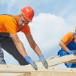 Stock Photo: Roofers carpenters works on roof