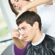 Hairdresser woman at haircut work — Stockfoto