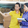 Two chinese female workers in warehouse — Stock Photo #30769863
