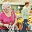 Adult womshopping vegetables — Stock Photo #30769959