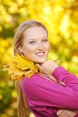 Smiling woman at autumn — Stock Photo