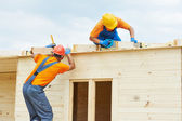 Carpenters at wooden roof work — Stock Photo