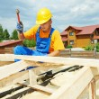 Stock Photo: Roofer works on roof