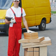 Delivery man with box — Stock Photo