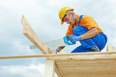 Carpenter works with hand saw — Stock Photo