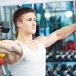 Bodybuilder man training with dumbbells — Stock Photo
