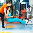 Woman with trainer at training simulator — Stock Photo