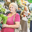 Adult woman shopping vegetables — Stock Photo