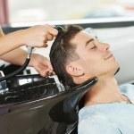 Man hair washing in hairdressing salon — Stock Photo #30979521
