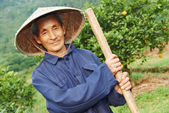 Agricultural farm worker in china — Stock Photo