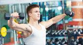 Bodybuilder man training with dumbbells — Stock Photo