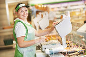 Saleswoman in supermarket shop — Stock Photo