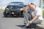 Upset man after car crash — Stock Photo