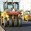 Stock Photo: Pneumatic asphalt roller at work